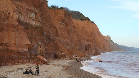 People under the eroding cliffs at East Beach, Sidmouth. Ref shs cliff hangers SH-13-17-05. Picture:
