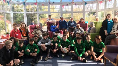 Sidmouth Warriors Under-14 players with residents and staff at the Malden House Care Home who have b