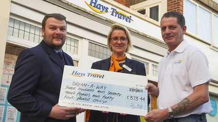Hays Travel manager Danny Marish and his colleague Debbie O'Connor presenting the cheque for £373.44