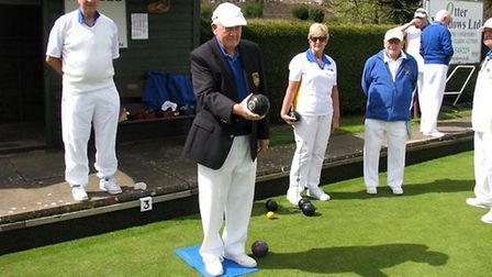 Ottery St Mary Bowls Club president Gerry Beighton preparing to bowl the first wood of the 'Opening