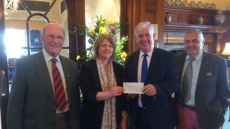 Keith Walton and organiser Nigel Sharp present a cheque of £2,500 to Sidmouth Hospiscare. Photo: Adr