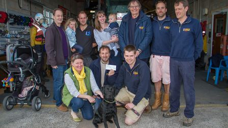 Rescued dog, Star, with the Sidmouth Lifeboat crew. Ref shs 16-17TI 1185. Picture: Terry Ife