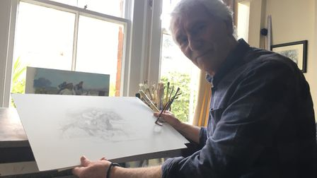 Michael Heslop with sketches of the stamp.