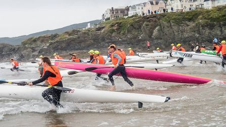 Ocean ski competitors taking to the water. Photo by Gordon Dryburgh