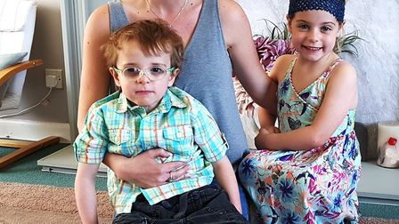Three-year-old Mikey Hall with mum Kat and sister Chloe