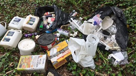 Fly-tipping at a private woodland in Newton Poppleford