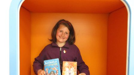 Thailita Carnell, 10, is the first to complete the Book Track challenge in Ottery's newly opened lib