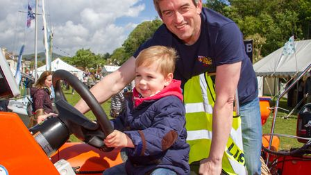 Theo Perry at the controls of the lifeboat with crew member Jim Brewster at the Sidmouth Sea Fest. R