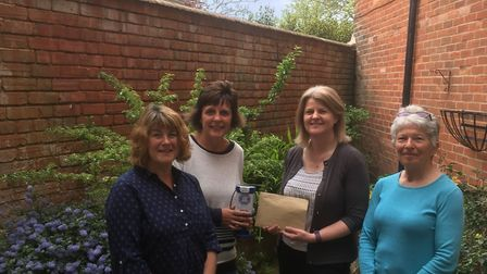 Gill Ryalls (CEO of Sidmouth Hospiscare) with members of both the tennis club and Sidmouth Hospiscar