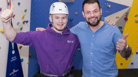 It's a thumbs-up for the new climbing wall from Invictus champion Paul Vice (right) and instructor C