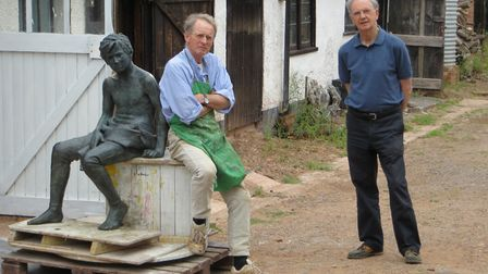 The start of a long journey: Sculptor Nicholas Dimbleby (left) next to a current commission, with Jo