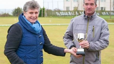 Ian Burridge receives the Haste Cup from Amanda Haste after his win at Sidmouth