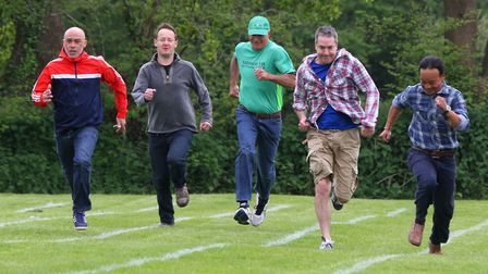 Sidford fete. The runners were really competitive for the dad's race. Ref shs 7288-21-15AW. Picture: