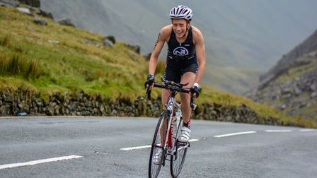 N1 Tri Club member Ellie Dominey cycling up the Llanberis Pass in the Slateman Triathlon.
