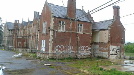 Scaffolding is beginning to go up around the former Salston Manor as work begins.
