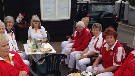 Sidmouth bowlers enjoy a spot of pst match tea and cake at Shaldon