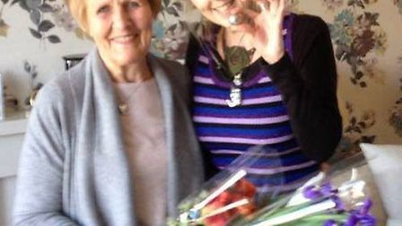 Norma Grant was presented with flowers by Claire Rosewood after the Newton Poppleford resident helpe