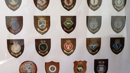 Mementoes from each of Paul Haines' commissions while he was in the Royal Navy