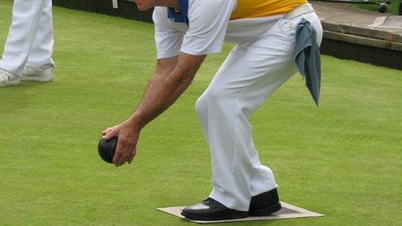 Ottery St Mary bowler Dave Brown in action in a recent game, who has been presented with his County
