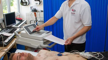 Alex Hayman being tested at the free CRY screenings with cardiac physiologist Rob Pring. Ref shs 23-