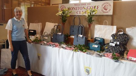 Honiton lady captain Janet Hughes with the Open meeting prize table