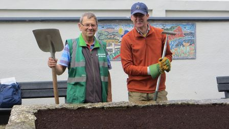 Sidmouth in Bloom treasurer Peter Endersby and volunteer Graham Hutchinson prepared the planter at t