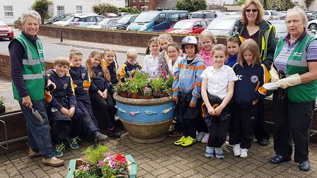 Pupils from St John's School and Insight School in St Petersburg helped Sidmouth in Bloom fill plant