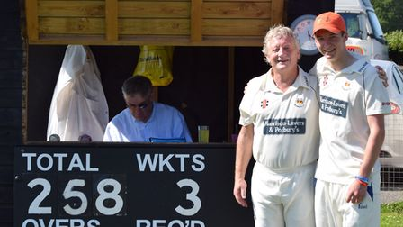 Byron Knowles together with Graham Munday after their double century partnership for Sidmouth III in