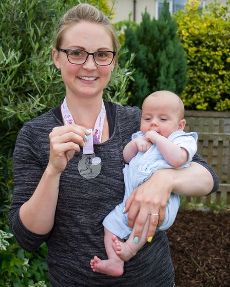 Women Can Marathon runner Jessica Raynor and baby Artie. Ref shs 22-17TI 3636. Picture: Terry Ife