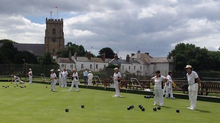 Sidmouth bowlers in home action