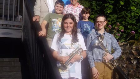 Young members of Sidmouth Town Band with their leader, Fiona Harvey, Ann Liverton and John Hollick,