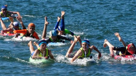 Sidmouth Surf Lifesaving group take to the water on Sunday.