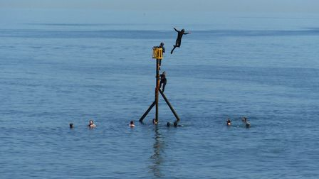 Tombstoning from a sea marker in Sidmouth. Picture: Contributed
