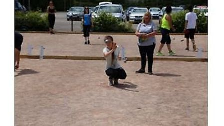 Action from a singles petanque match