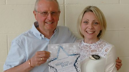 Brian Rice was named Sidmouth Slimming World's man of the year. He holds up his certificate with co-