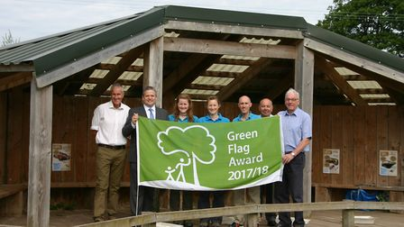 Celebrating the Green Flag award for Seaton Wetlands are, from left, Charlie Plowden (EDDC service l