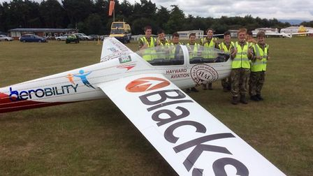 Air Cadets from the the Devon and Somerset Wing beside a glider at Devon and Somerset Giiding Club