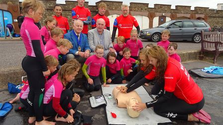 Councillors watch members of the Sidmouth Surf Lifesaving Club training with the new CPR mannequin o