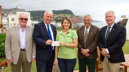 Outgoing President Keith Walton handing cheque to Laura Board of CHSW. Ref shs 26 17TI 6128. Picture