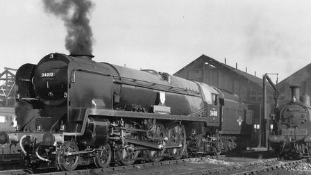 34010 Sidmouth seen at Eastleigh loco-shed in 1959, with plenty of smoke in its chimney.