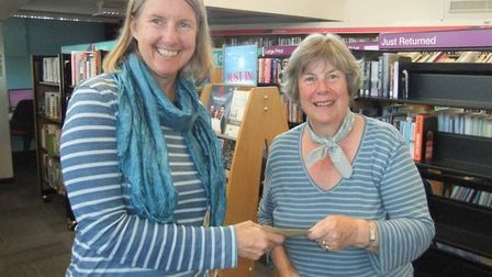 Poet and playwright Alyson Hallett (left) presents Janet, from West Hill with her prize.