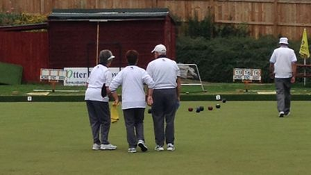 Sidmouth bowlers in action at Seaton