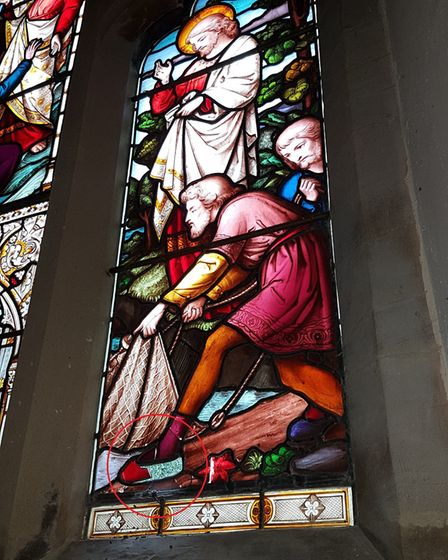 The burglary damaged this 150-year-old stained glass window before breaking through another