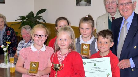 Pupils from Seaton Primary School pick up the awards for the best vegetable plot, the longest runner