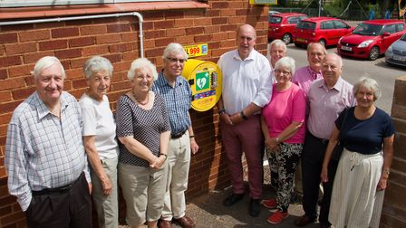 Members of Sidford Hall with their new defibrillator. Ref shs 29 17TI 7572.