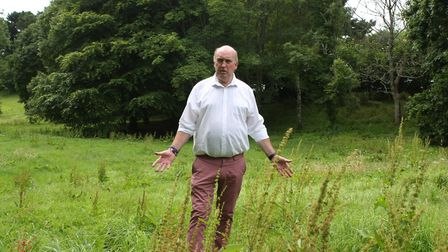 Stuart Hughes in the uncut grass at The Knowle. shs 29 17AB 7141. Picture: Antonia Bohm