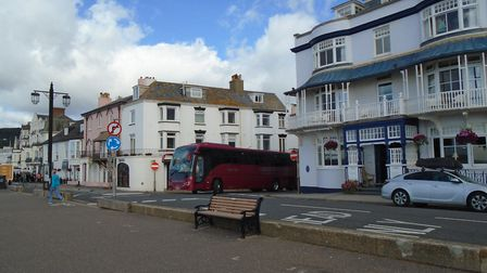 A coach on Sidmouth seafront.