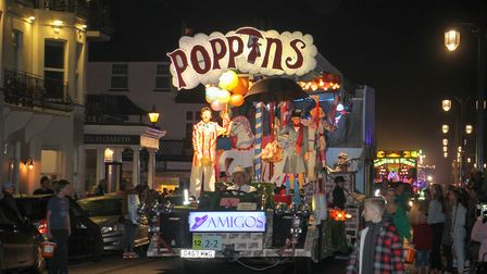 Mary Poppins flies into town at the Sidmouth carnival. Ref shs 39-16TI 8723. Picture: Terry Ife