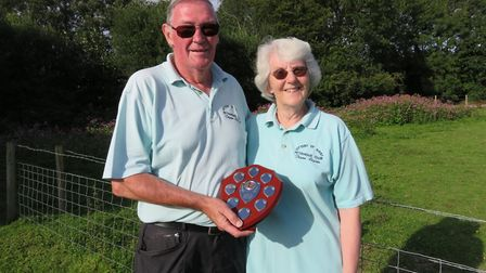 Ottery St Mary petanque players Peter and Sue Smith with the Devon Petanque Plate trophy that they w