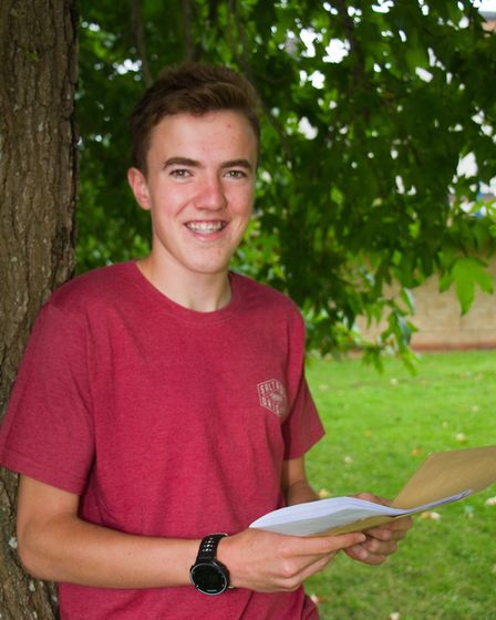 Toby Garrett with his GCSE results at Sidmouth College. Ref shs 34 17TI 9726. Picture: Terry Ife